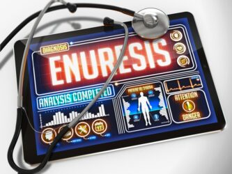 What is nocturnal enuresis?
